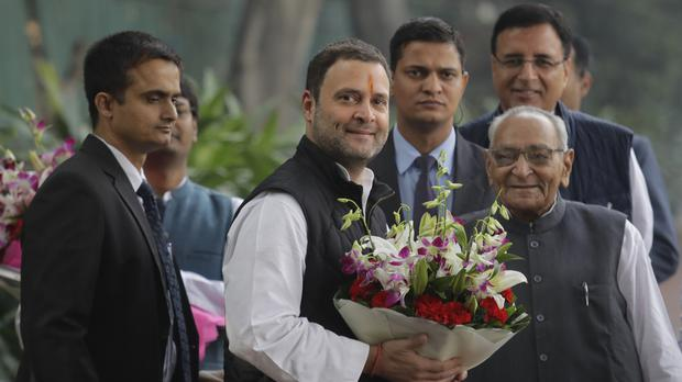 Senior Congress party leaders welcome Rahul Gandhi as he arrives to file his nomination papers at party headquarters, in New Delhi, India, on Monday (AP)