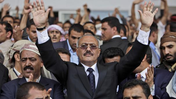 File photo from 2011 of then Yemeni president Ali Abdullah Saleh waving to supporters (AP)