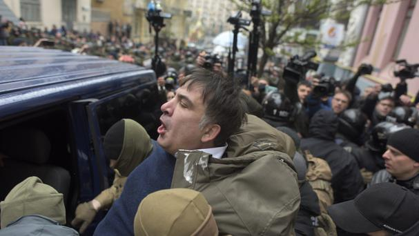 Ukrainian Security Service officers detain Mikheil Saakashvili at his house in Kiev (Evgeniy Maloletka/AP)
