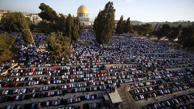 Palestinians pray near the Dome of the Rock Mosque in the Al Aqsa Mosque compound in Jerusalem's old city (Mahmoud Illean/AP)