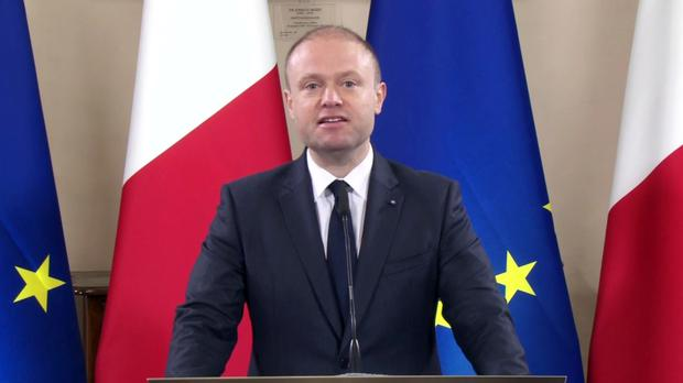Malta's PM Joseph Muscat gives a statement to announce the arrest of eight suspects in the murder of investigative journalist Daphne Caruana Galizia, in Valletta (AP)