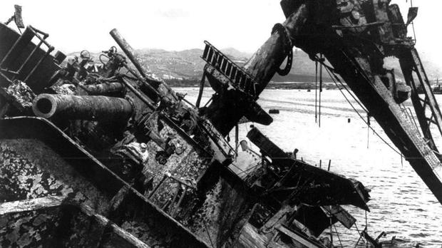 The USS Oklahoma capsized during the Japanese bombing of Pearl Harbour 76 years ago (AP Photo, File)
