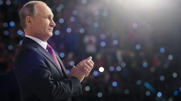 Vladimir Putin attends the Volunteer of Russia 2017 award ceremony at the Megasport Sport Palace in Moscow (Alexei Druzhinin, Sputnik, Kremlin Pool Photo via AP)