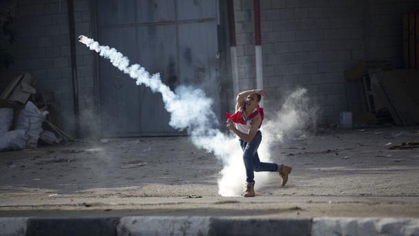 Palestinians clash with Israeli troops during a protest in the West Bank City of Nablus (Majdi Mohammed/AP)