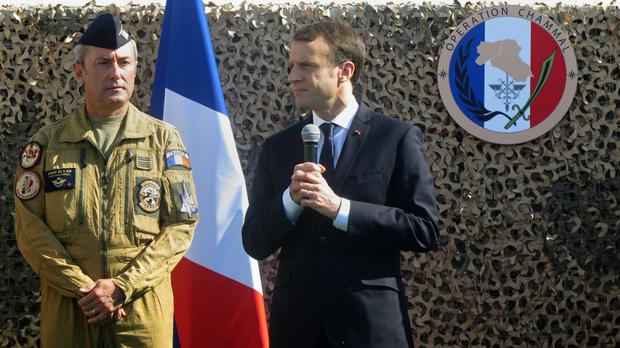 President Emmanuel Macron speaks to French troops at the Al-Udeid base in Qatar (Fay Abuelgasim/AP)