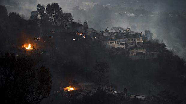 A hilltop mansion in the Bel Air district of Los Angeles where wildfires have reached wealthy neighbourhoods (AP/Jae C. Hong)