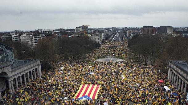 Pro-independence Catalan supporters gather for a demonstration near the EU quarter in Brussels (Virginia Mayo/AP)