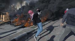 Palestinian protesters clash with Israeli troops in the West Bank city of Ramallah (Nasser Nasser/AP)