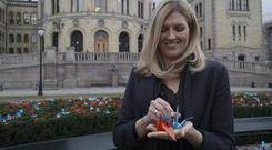 Beatrice Fihn, the executive director of the International Campaign to Abolish Nuclear Weapons, holds two paper cranes in Oslo (David Keyton/AP)
