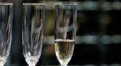 The business class air passenger denied more champagne became aggressive