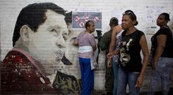 A mural of Venezuela's late President Hugo Chavez at a school serving as a polling station in Caracas (AP/Ariana Cubillos)