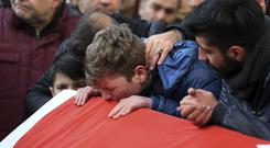 Family and friends during the funeral for Ayhan Akin, one of the victims of the nightclub shooting (AP Photo)