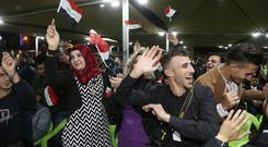 Celebrations in Iraq following the defeat of Islamic State (AP)