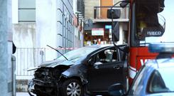 The car that was driven into a pedestrian-only square seriously injuring a woman near an outdoor skating ring near the Sondrio market, Italy, before crashing into a pillar (AP).