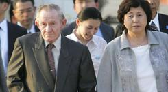 Charles Jenkins, his wife Hitomi Soga, right, and their daughter Mika, centre, at Tokyo's Haneda International Airport (AP/Itsuo Inouye)