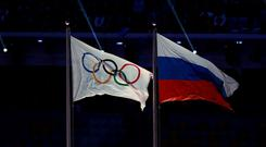 The Russian flag next to the Olympic flag