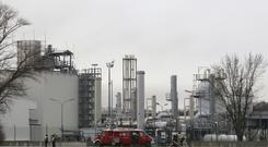 Firefighters stand outside the Baumgarten an der March gas plant (AP/Ronald Zak)