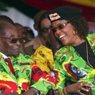 Robert Mugabe with his wife Grace (AP)