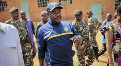 File picture of Burundi's President Pierre Nkurunziza walking to a polling station (AP)