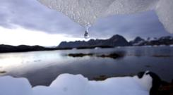 An iceberg melts in Kulusuk, Greenland near the arctic circle. (AP/John McConnico)