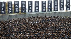 A minute's silence is observed on the 80th anniversary of the Nanking Massacre (AP)