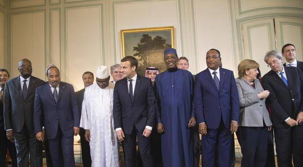 Emmanuel Macron with delegates at his conference on tackling extremism in Africa's Sahel region (AP)