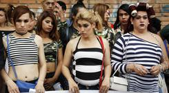 Members of a gay organisation protest the killing of transvestite prostitutes and demand equal rights for gays during the annual LGBQT parade in Asuncion, Paraguay. (AP Photo/Jorge Saenz)