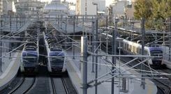 Trains sit at a deserted central railway station in Athens (AP)
