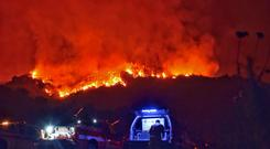 Firefighters at the scene above Montecito, California (Santa Barbara County Fire Department/AP)