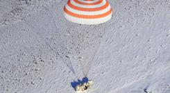 The Russian Soyuz MS-05 space capsule lands about 90 miles south east of the Kazakh town of Zhezkazgan. (AP)