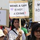 Indonesian activists during a protest demanding equality for LGBT people in Jakarta (AP)