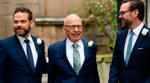 Rupert Murdoch, flanked by sons Lachlan, left, and James, right