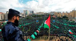 Hamas supporters take part in a rally marking the 30th anniversary of the founding of the Islamist movement, in Gaza City yesterday. Photo: Mohammed Abedmohammed/Getty