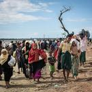 Rohingya are seen after arriving on a boat to Bangladesh in Shah Porir Dip back in September