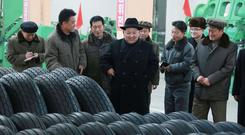 North Korean leader Kim Jong Un, centre, (Korean Central News Agency/Korea News Service via AP)