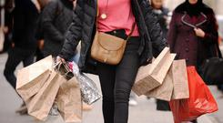 A person carrying shopping bags, as H and M announces that will close some stores (PA)
