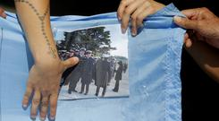Families of the 44 crew members of the submarine ARA San Juan march in Mar del Plata, Argentina, one month after the submarine's disappearance (AP)