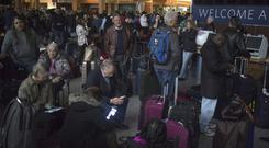 Passengers wait in a dark terminal at Hartsfield-Jackson International Airport after a sudden power outage (AP)