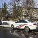 Police cars outside the home of billionaire Barry Sherman in Toronto (AP)