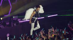 Jonghyun, pictured on stage with South Korean band SHINee, in 2012 (AP)