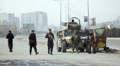 Security forces guard at the site of a clash between gunmen and security forces in Kabul (AP)