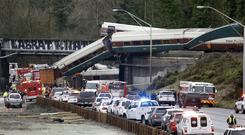 Cars from an Amtrak train lay spilled on to Interstate 5 in DuPont, Washington (AP)