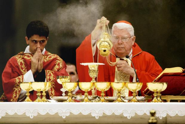 Cardinal Bernard Law (right) celebrates a mourning Mass for the late Pope John Paul II in the Vatican in 2005