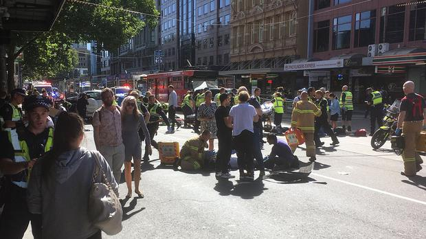 Paramedics treat a victim after a car ploughed into pedestrians in Melbourne (Andrew Lund/Twitter)