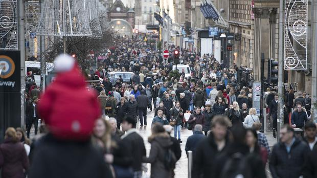 Shoppers in the rundown to Christmas on Buchanan Street in Glasgow city centre (PA)