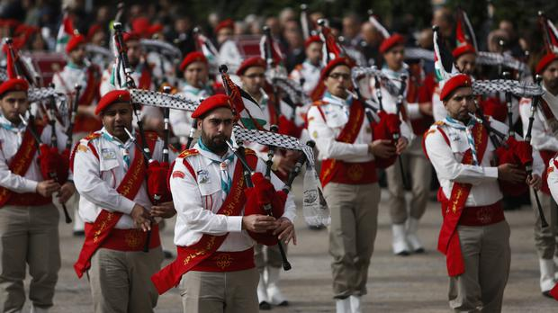 Members of a Palestinian marching band parade during Christmas celebrations outside the Church of the Nativity, built atop the site where Christians believe Jesus Christ was born, on Christmas Eve, in the West Bank City of Bethlehem, Sunday, Dec. 24, 2017. (AP Photo/Majdi Mohammed)