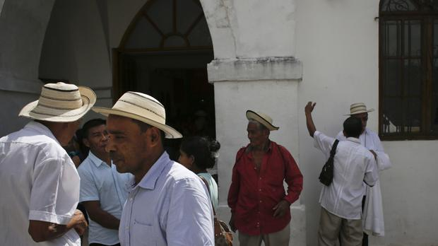 Men wearing traditional Panamanian pintao hats leave Sunday Mass in La Pintada, Panama (AP)