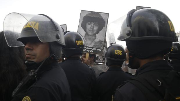 Demonstrators protest against a medical pardon to former president Alberto Fujimori (AP Photo/Martin Mejia)