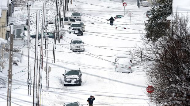 Residents in Erie dig their way out after a record two-day snowfall