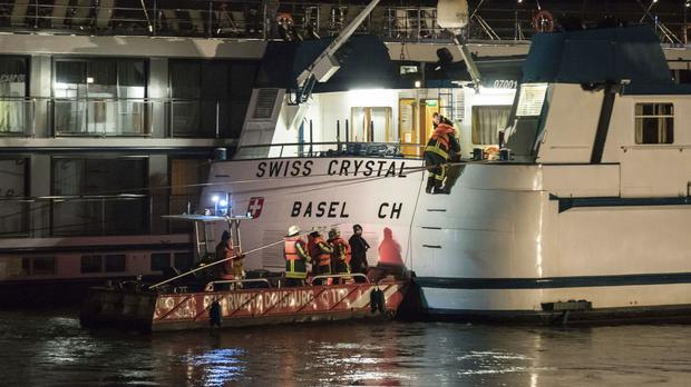 Rescuers arrive at a tourist ship in Germany (Marcel Kusch/dpa via AP)
